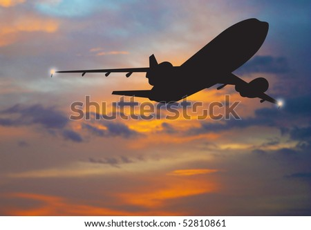 airliner landing at sunset - stock photo
