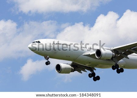 Airliner on approach to land - stock photo