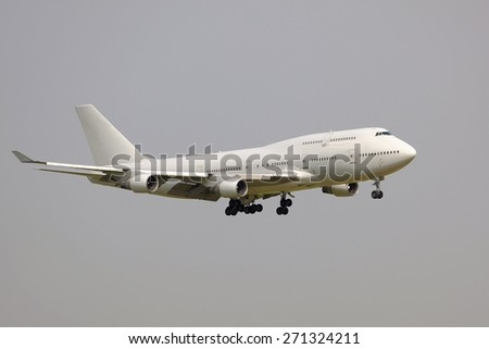 Airliner on final approach - stock photo