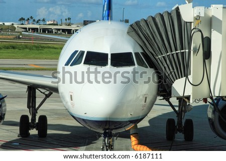 Airliner parked at the gate ready for boarding - stock photo