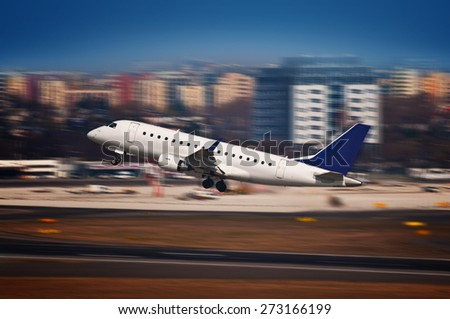 Airliner plane taking off from the airport with dynamic motion blur effect - stock photo