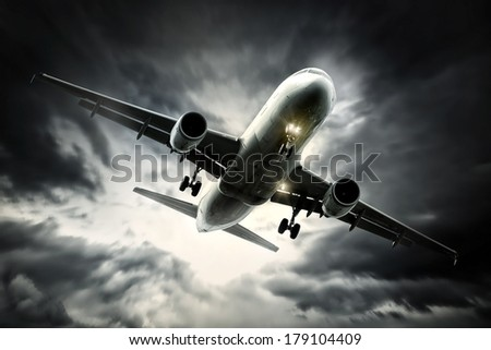 Airliner preparing for landing with a stormy sky - stock photo