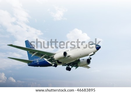 Airliner takeoff against bright sky - stock photo
