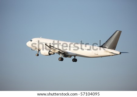 Airliner taking off - blue sky - stock photo