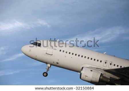 airliner taking off in a blue sky - stock photo
