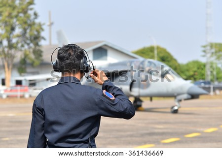 Airman speaking to the fighter pilots whit radio communication. - stock photo