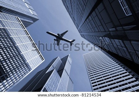 Airplane above city of Chicago. - stock photo