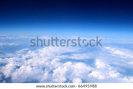 Airplane above clouds - stock photo