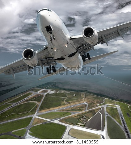 Airplane above the airport - stock photo