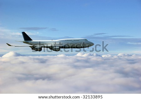 Airplane above the clouds - stock photo