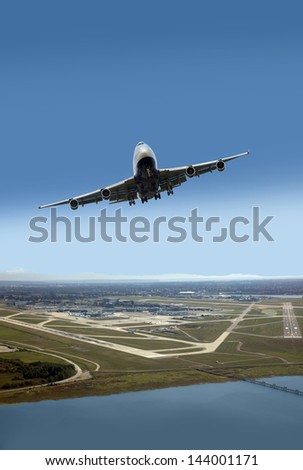 Airplane after taking off from airport - stock photo