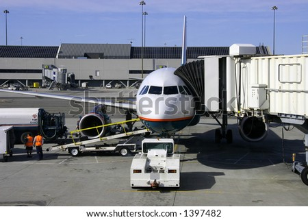 Airplane and Jetway - stock photo