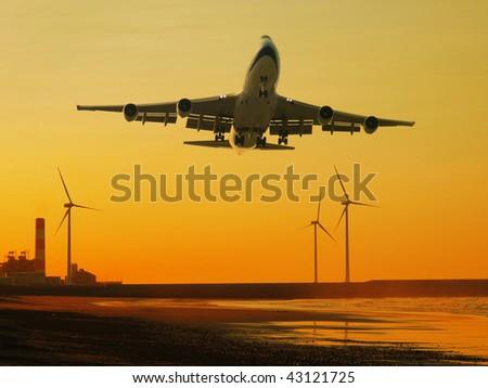 Airplane and wind power generator - stock photo