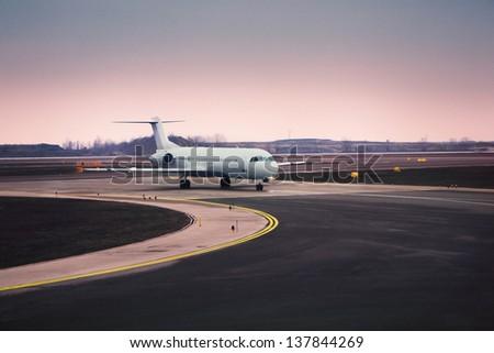 Airplane at airport - stock photo