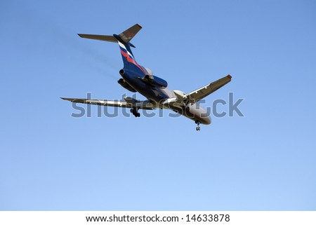Airplane at blue sky. Image with clipping path.