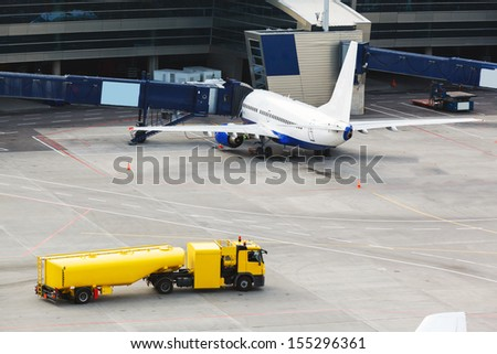 airplane at gate and gangways for the plane - stock photo