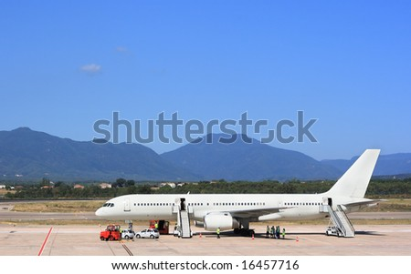 Airplane at the airport - stock photo