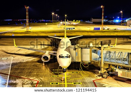 Airplane at the gate - stock photo