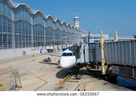 Airplane at the Gate in Ronald Reagan Washington National Airport - stock photo