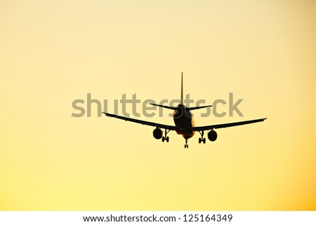 Airplane at the sunset