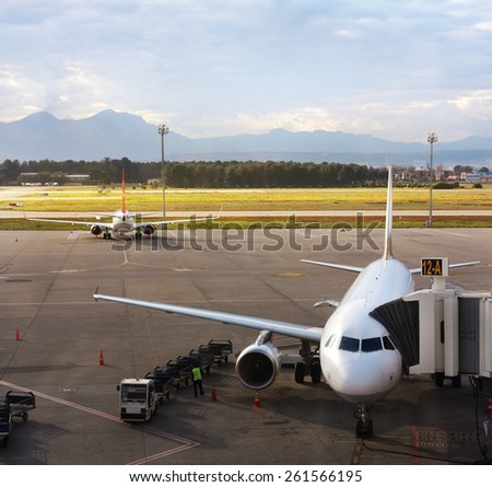 Airplane at the terminal gate getting ready for takeoff - stock photo