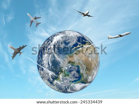 Airplane away from the earth. Elements of this image furnished by NASA.  - stock photo