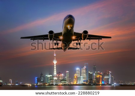 airplane, background of the shanghai skyline