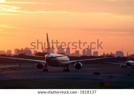 airplane before New York skyline, at departure, at sunset - stock photo