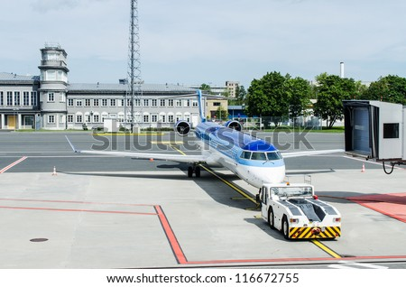 Airplane being towed to ramp at airport - stock photo