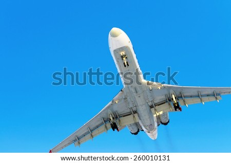 Airplane blue sky clouds flight airport - stock photo