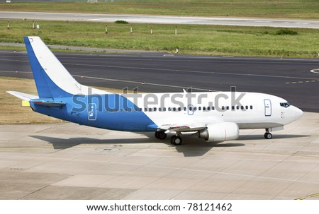 Airplane Boeing 737-548 landed in the airport - stock photo