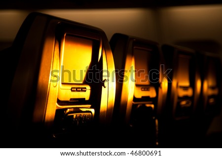 Airplane chairs lighted by sunset - stock photo