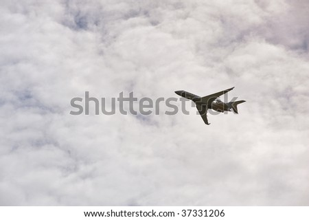airplane climbing into a cloudy sky