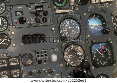 Airplane cockpit instrument panel background - stock photo