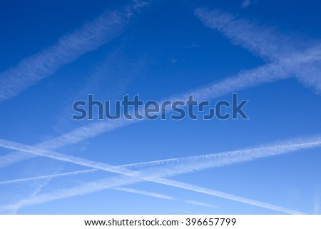 Airplane contrails in the blue sky