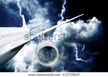 airplane crash in a storm with lightning concept. accident airplane in the sky. emergency landing. flights in bad weather - stock photo