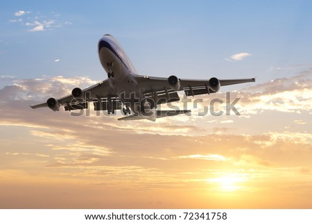 airplane departed at dusk with dramatic sky - stock photo