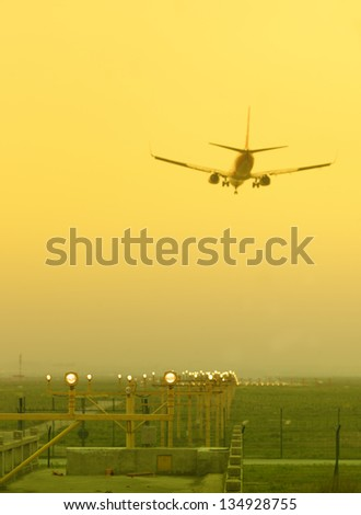 Airplane descending at airport in the sunset,shanghai,China - stock photo