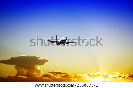 Airplane during the landing phase - stock photo