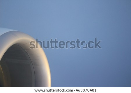 Airplane engine with clear blue sky background