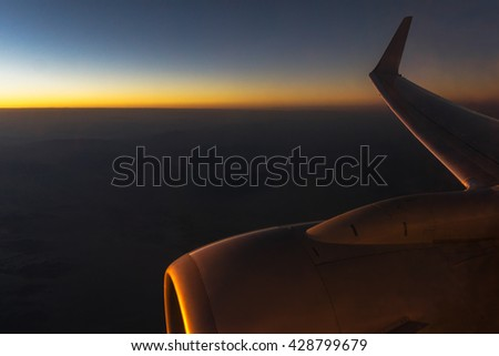 Airplane Flight at Sunset