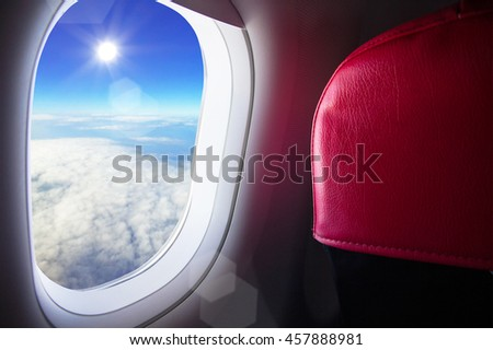 Airplane fly above cloud view from window with blue sky beautiful sunny looking out your window - Travel by plane concept