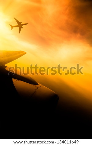 airplane fly at sunset sky background. - stock photo