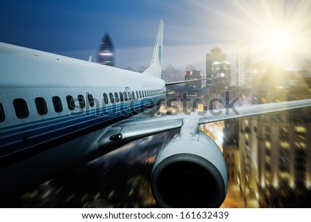 airplane fly away the city background. - stock photo