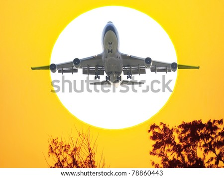 Airplane fly in sunset - stock photo