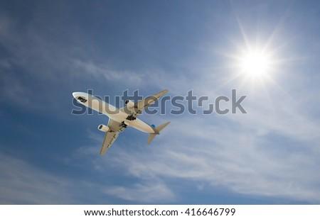 Airplane fly on sky blue sunny - stock photo