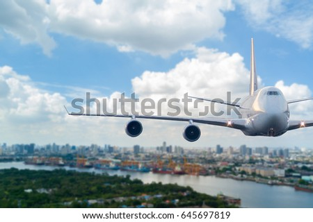 airplane fly over the city