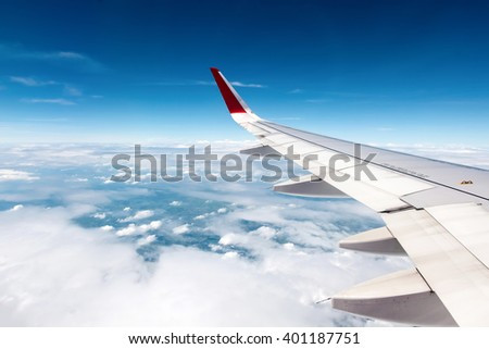 Airplane flying above clouds - stock photo