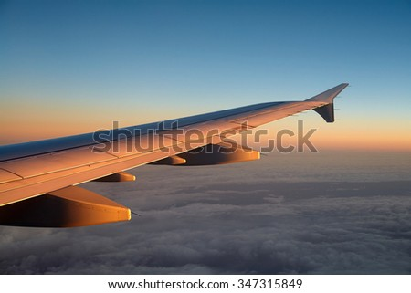Airplane flying above clouds great travel transportation background image - stock photo
