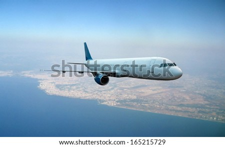 Airplane flying above earth background  - stock photo